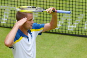 Mikhail Youzhny of Russia celebrates after winning his match against Kei Nishikori of Japan during day three of the Gerry Weber Open at Gerry Weber...