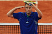 Mikhail Youzhny of Russia celebrates after winning his quarter final match against Marin Cilic of Croatia during the betathome German Open Tennis...