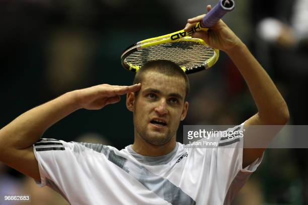 Mikhail Youzhny of Russia celebrates defeating Novak Djokovic of Serbia during day six of the ABN AMBRO World Tennis Tournament on February 13 2010...