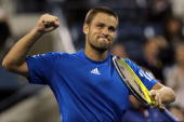 Mikhail Youzhny of Russia celebrates defeating Stanislas Wawrinka of Switzerland during his men's single quarterfinal match on day eleven of the 2010...