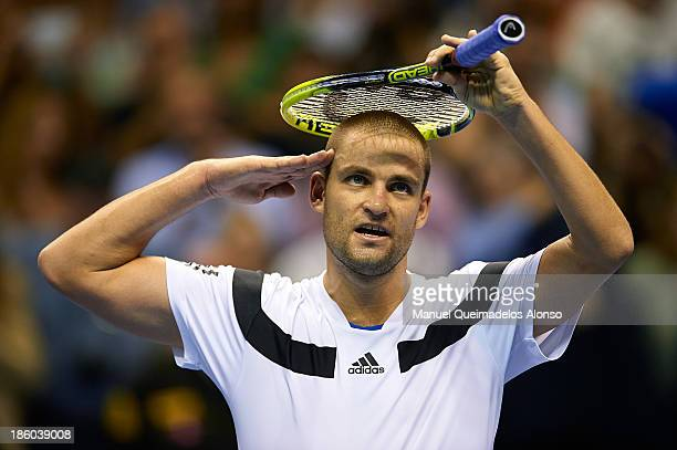 Mikhail Youzhny of Russia celebrates during his Men's Singles match against David Ferrer of Spain during the final of the Valencia Open 500 at the...