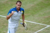 Mikhail Youzhny of Russia celebrates in the final match against Roger Federer of Switzerland during the final day of the Gerry Weber Open at Gerry...
