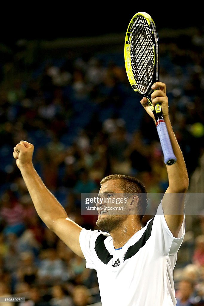 Mikhail Youzhny of Russia celebrates match point against Tommy Haas of Germany during their third round match on Day Seven of the 2013 US Open at USTA Billie Jean King National Tennis Center on September 1, 2013 in the Flushing neighborhood of the Queens borough of New York City.
