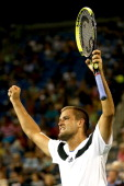 Mikhail Youzhny of Russia celebrates match point against Tommy Haas of Germany during their third round match on Day Seven of the 2013 US Open at...