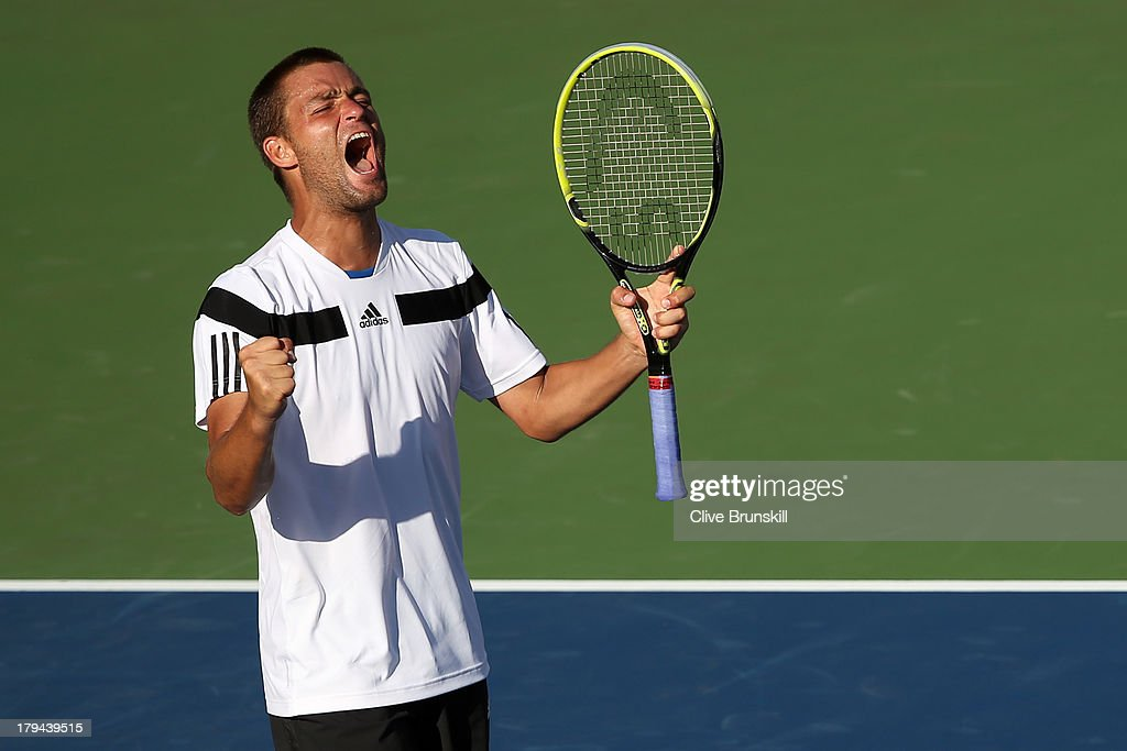 <a gi-track='captionPersonalityLinkClicked' href=/galleries/search?phrase=Mikhail+Youzhny&family=editorial&specificpeople=171709 ng-click='$event.stopPropagation()'>Mikhail Youzhny</a> of Russia celebrates match point during his men's singles fourth round match against Lleyton Hewitt of Australia on Day Nine of the 2013 US Open at USTA Billie Jean King National Tennis Center on September 3, 2013 in the Flushing neighborhood of the Queens borough of New York City.