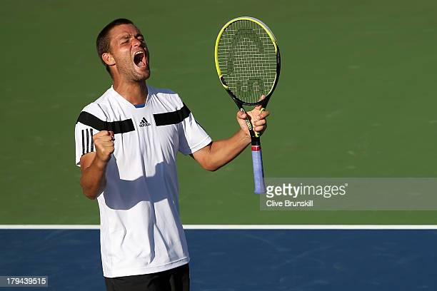 Mikhail Youzhny of Russia celebrates match point during his men's singles fourth round match against Lleyton Hewitt of Australia on Day Nine of the...