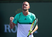 Mikhail Youzhny of Russia celebrates winning a game in his match against Aljaz Bedene of Great Britain during day five of the BNP Paribas Open at...