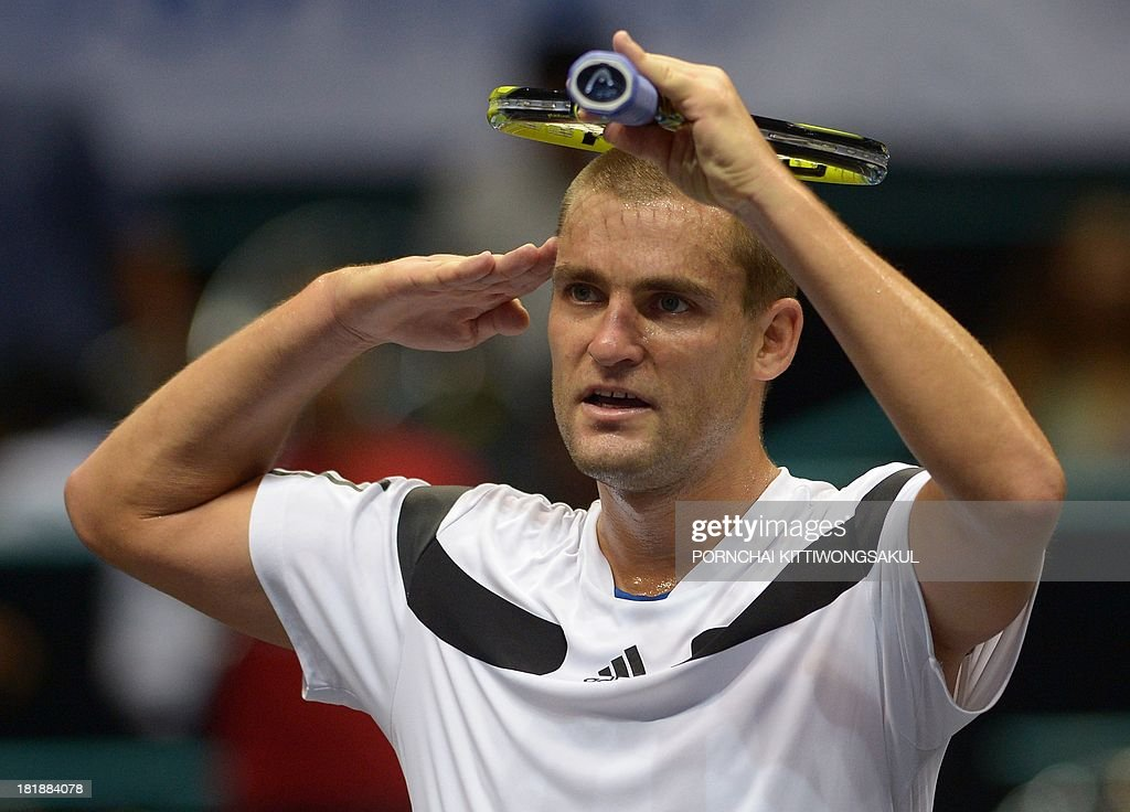 Mikhail Youzhny of Russia gestures to his fans after winning against Denis Istomin of the Ukraine during the second round of Tennis ATP Thailand Open 2013 tournament in Bangkok on September 26, 2013. Youzhny beat Istomin 6-3, 6-3. AFP PHOTO / PORNCHAI KITTIWONGSAKUL
