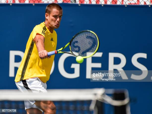 Mikhail Youzhny of Russia hits a return shot against Borna Coric of Croatia during day five of the Rogers Cup presented by National Bank at Uniprix...