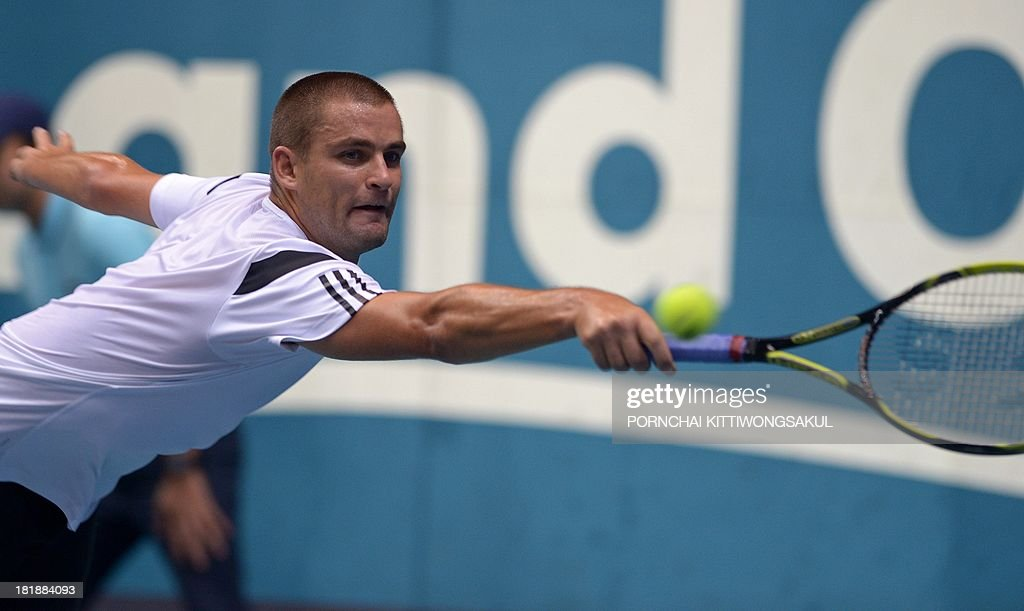 Mikhail Youzhny of Russia hits a return to Denis Istomin of the Ukraine during the second round of Tennis ATP Thailand Open 2013 tournament in Bangkok on September 26, 2013. Youzhny beat Istomin 6-3, 6-3.