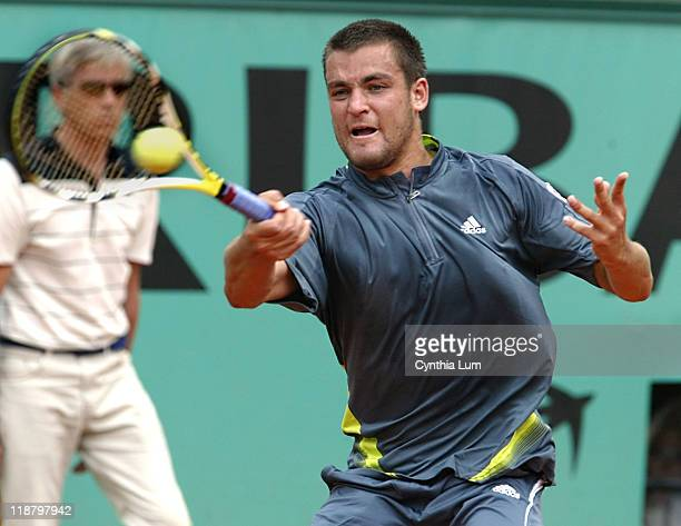 Mikhail Youzhny of Russia in action during his 76 64 64 loss to Roger Federer of Switzerland in the fourth round of the French Open at Roland Garros...