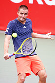 Mikhail Youzhny of Russia in action during the men's singles match against Gilles Simon of France on day two of Rakuten Open 2015 at Ariake Colosseum...