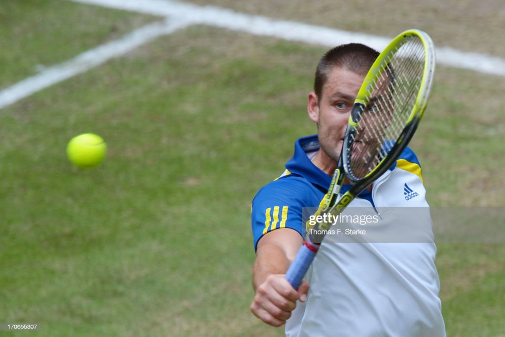 <a gi-track='captionPersonalityLinkClicked' href=/galleries/search?phrase=Mikhail+Youzhny&family=editorial&specificpeople=171709 ng-click='$event.stopPropagation()'>Mikhail Youzhny</a> of Russia play a backhand in the final match against Roger Federer of Switzerland during the final day of the Gerry Weber Open at Gerry Weber Stadium on June 16, 2013 in Halle, Germany.