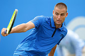 Mikhail Youzhny of Russia plays a backhand during his men's singles match against Gilles Muller of Luxembourg during day three of the ATP Aegon Open...