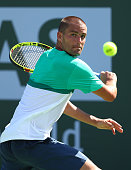 Mikhail Youzhny of Russia plays a backhand in his match against Aljaz Bedene of Great Britain during day five of the BNP Paribas Open at Indian Wells...