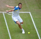 Mikhail Youzhny of Russia plays a backhand in the half final match against Richard Gasquet of France during day six of the Gerry Weber Open at Gerry...