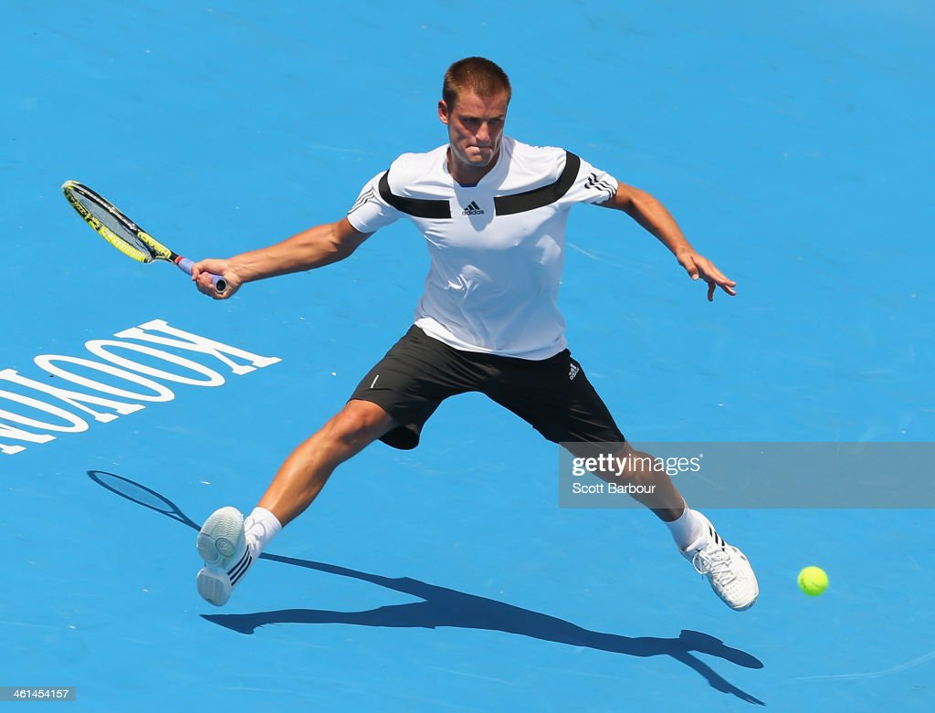 <a gi-track='captionPersonalityLinkClicked' href=/galleries/search?phrase=Mikhail+Youzhny&family=editorial&specificpeople=171709 ng-click='$event.stopPropagation()'>Mikhail Youzhny</a> of Russia plays a forehand during his match against Jordan Thompson of Australia during day two of the AAMI Classic at Kooyong on January 9, 2014 in Melbourne, Australia.