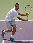 Mikhail Youzhny of Russia plays a match against Kei Nishikori of Japan during Day 6 of the Miami Open presented by Itau at Crandon Park Tennis Center...