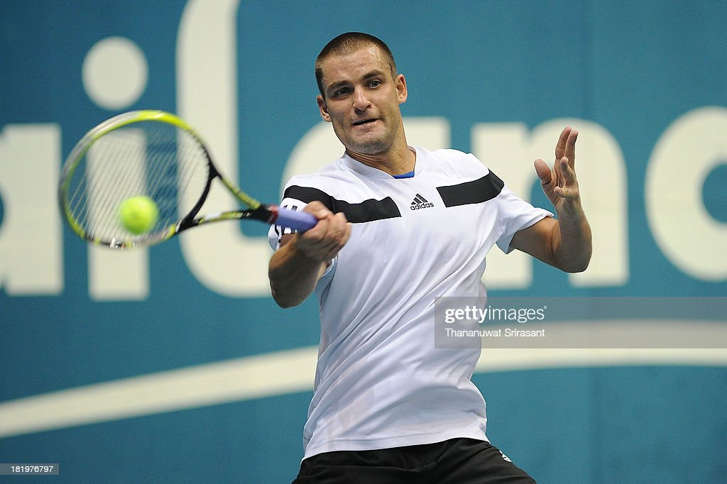 <a gi-track='captionPersonalityLinkClicked' href=/galleries/search?phrase=Mikhail+Youzhny&family=editorial&specificpeople=171709 ng-click='$event.stopPropagation()'>Mikhail Youzhny</a> of Russia plays a shot in his match against Denis Istomin of Uzbekistan during the 2013 Thailand Open at Impact Arena on September 26, 2013 in Bangkok, Thailand.