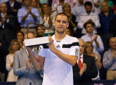 Mikhail Youzhny of Russia poses with the trophy after his match against David Ferrer of Spain in the final of the Valencia Open 500 at the Ciudad de...