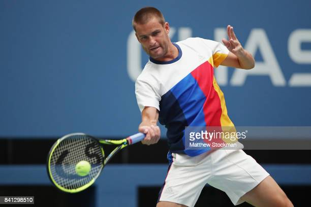 Mikhail Youzhny of Russia reacts against Roger Federer of Switzerland during their second round Men's Singles match on Day Four of the 2017 US Open...