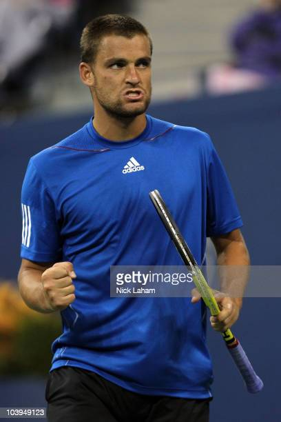 Mikhail Youzhny of Russia reacts against Stanislas Wawrinka of Switzerland during his men's single quarterfinal match on day eleven of the 2010 US...
