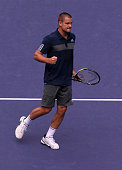 Mikhail Youzhny of Russia reacts during his match against Ernests Gulbis of Latvia during the day 3 of the Shanghai Rolex Masters at the Qi Zhong...