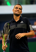 Mikhail Youzhny of Russia reacts during his match against Feliciano Lopez of Spain during the day 6 of the Shanghai Rolex Masters at the Qi Zhong...