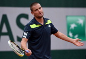 Mikhail Youzhny of Russia reacts during his men's singles match against Radek Stepanek of Czech Republic on day four of the French Open at Roland...
