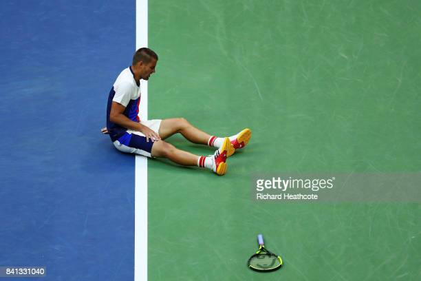 Mikhail Youzhny of Russia reacts on the ground against Roger Federer of Switzerland during their second round Men's Singles match on Day Four of the...