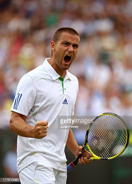 Mikhail Youzhny of Russia reacts to a play during his fourth round match against Roger Federer of Switzerland on Day Seven of the Wimbledon Lawn...