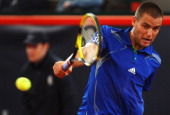 Mikhail Youzhny of Russia returns a backhand during his semi final match against Gilles Simon of France during the betathome German Open Tennis...
