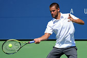 Mikhail Youzhny of Russia returns a shot against Nick Kyrgios of Australia during his men's singles first round match on Day One of the 2014 US Open...