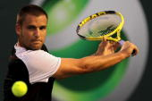 Mikhail Youzhny of Russia returns a shot against Robin Soderling of Switzerland during day ten of the 2010 Sony Ericsson Open at Crandon Park Tennis...