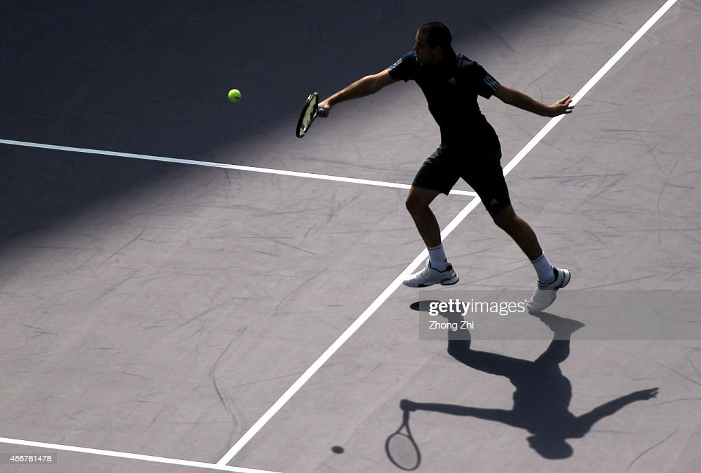 <a gi-track='captionPersonalityLinkClicked' href=/galleries/search?phrase=Mikhail+Youzhny&family=editorial&specificpeople=171709 ng-click='$event.stopPropagation()'>Mikhail Youzhny</a> of Russia returns a shot during his match against Ernests Gulbis of Latvia during the day 3 of the Shanghai Rolex Masters at the Qi Zhong Tennis Center on October 7, 2014 in Shanghai, China.
