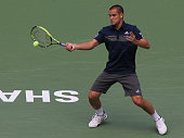 Mikhail Youzhny of Russia returns a shot during his match against Ernests Gulbis of Latvia during the day 3 of the Shanghai Rolex Masters at the Qi...