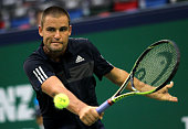 Mikhail Youzhny of Russia returns a shot during his match against Feliciano Lopez of Spain during the day 6 of the Shanghai Rolex Masters at the Qi...