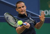 Mikhail Youzhny of Russia returns a shot during the Men's Singles Quarterfinal match against Feliciano Lopez of Spain during the day 6 of the...