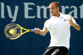 Mikhail Youzhny of Russia returns a shot to Alexandr Dolgopolov of the Ulraine during the Rogers Cup at the Rexall Centre on August 11 2010 in...