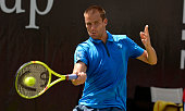 Mikhail Youzhny of Russia returns against Dominic Thiem of Austria during the quarterfinals on day 7 of Mercedes Cup 2016 on June 10 2016 in...