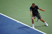 Mikhail Youzhny of Russia returns to JoWilfried Tsonga of France during a match on day 4 of the Western Southern Open on August 12 2014 in Cincinnati...