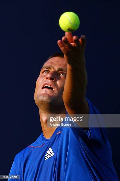 Mikhail Youzhny of Russia serves against Andrey Golubev of Kazakhstan during his men's singles first round match on day three of the 2010 US Open at...
