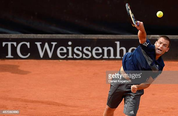 Mikhail Youzhny of Russia serves during his semifinal match against Lukas Rosol of Czech Republic during day six of MercedesCup at TC Weissenhof on...