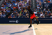 Mikhail Youzhny of Russia serves to John Isner of the United States during their Men's Singles Second Round match on Day Four of the 2015 US Open at...