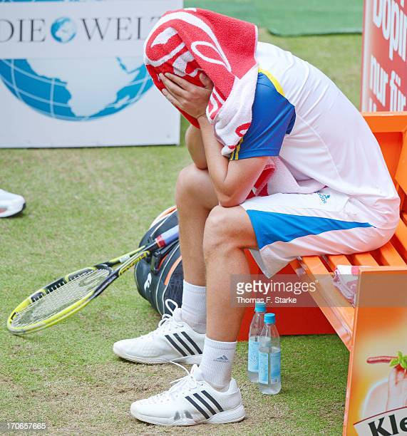 Mikhail Youzhny of Russia sits dejected on a bench in the final match against Roger Federer of Switzerland during the final day of the Gerry Weber...