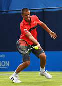 Mikhail Youzhny of Russia volleys in his men's singles first round match against Gilles Muller of Luxembourg during day two of the Aegon...