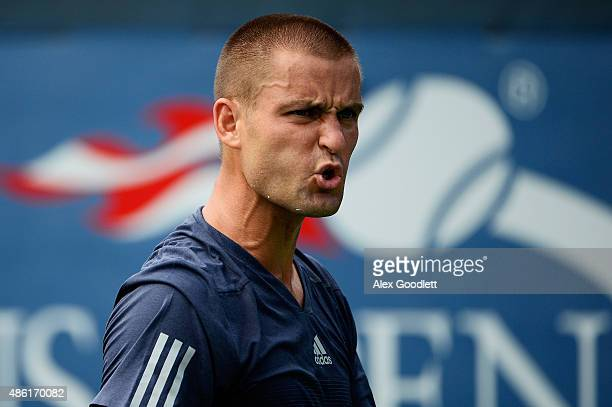 Mikhail Youzhny of Russian reacts against JohnPatrick Smith of Australia during their Men's Singles First Round match on Day Two of the 2015 US Open...