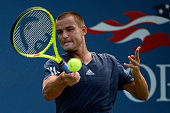 Mikhail Youzhny of Russian returns a shot against JohnPatrick Smith of Australia during their Men's Singles First Round match on Day Two of the 2015...
