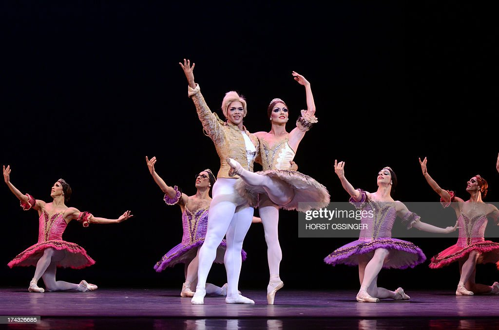 MikhailMypansarov (front L) and Yakaterina Verbosovich of the ballet company 'Les Ballets Trockadero de Monte Carlo' dance during a press call in occasion of the German premiere at the Rhine Opera inDuesseldorf, western Germany, on July 23, 2013. The German Opera on theRhine is hosting the drag ballet group from 23 until 28 July 2013.