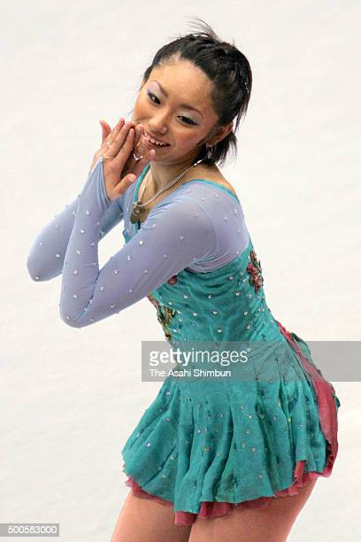 Miki Ando of Japan competes in the Figure Skating Women's Singles Free Program during day thirteen of the Torino Winter Olympics at Palavela on...